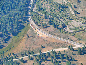 Aerial view of wildlife underpass under construction. The area's topography is too gentle to funnel animals to cross the road at a particular point. Instead, the Highway 89 Stewardship Team had to analyze years of carcass data and other information to determine the highest priority location for a crossing structure. Photo by Sara Holm, California Department of Fish and Game (CDFG)/Highway 89 Stewardship Team. Photo courtesy of Sandra Jacobson.
