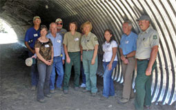 The Highway 89 Stewardship Team gathers in the Kyburz underpass to celebrate its dedication in June 2009. The team has representatives from nine entities, including the USDA Forest Service, California Department of Fish and Game, California Department of Transportation, UC Cooperative Extension, UC Davis, California Deer Association, Sierra County, and the NRS's Sagehen Creek Field Station. Photo courtesy of Sandra Jacobson.