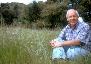 Phil Rundel sitting in a meadow.