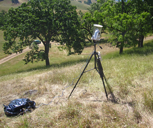 Clark deploys video cameras near coiled rattlesnakes to film potential interactions with ground squirrels. A wireless network relays the images to reserve headquarters. Image credit: B. Putman, San Diego State University