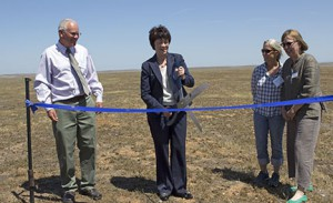 UC Merced Chancellor Dorothy Leland cuts the ceremonial ribbon at the Merced Vernal Pools and Grassland Reserve dedication as reserve director Chris Swarth, NRS director Peggy Fiedler, and reserve faculty manager Martha Conklin look on. Image credit: Lobsang Wangdu