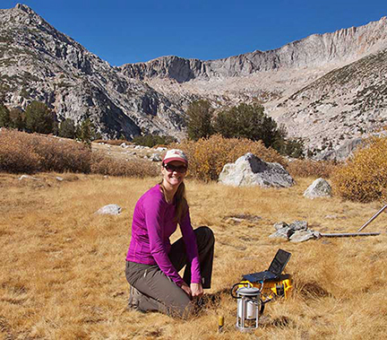 UC Merced graduate researcher Chelsea Arnold tests soil in the central Sierra. Photo courtesy Chelsea Arnold