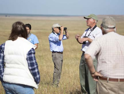 Vice Chancellor Sam Traina surveys the landscape as reserve director Cris Swarth leads conducts the tour. Image courtesy UC Merced